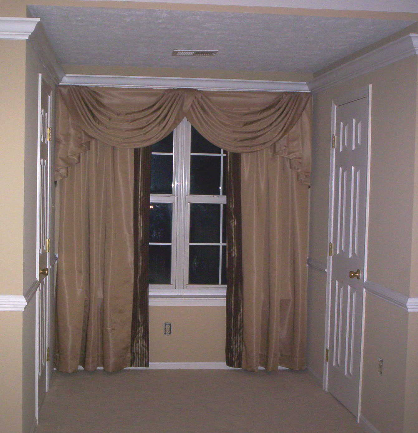 swag and drapes in bedroom